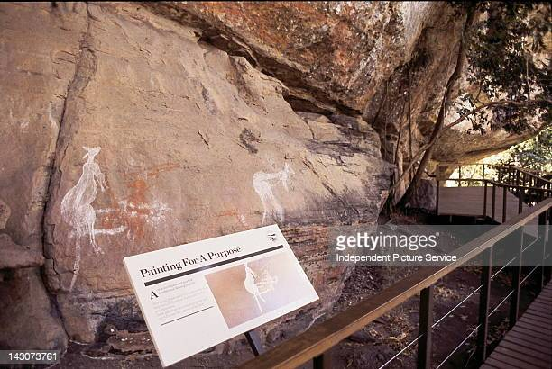 Interpretive sign and rock art at Kakadu National Park near Darwin Australia in the Northern Territory