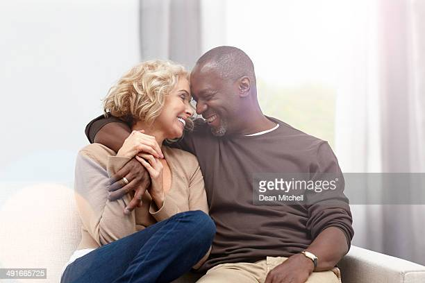 Interracial couple caught in a romantic moment