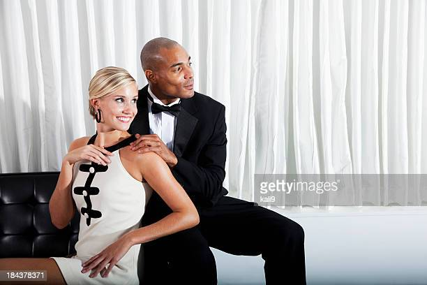 Interracial couple in formalwear