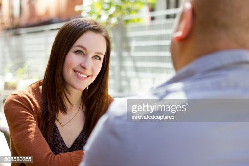 Interracial Couple on a First Date Outdoors : Bildbanksbilder
