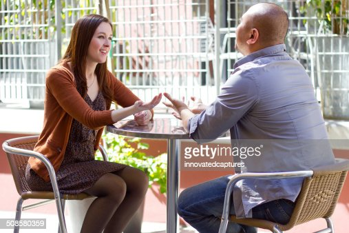 Interracial Couple on a First Date Outdoors : Stockfoto