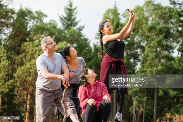 Interracial Eurasian Family Taking Selfie Photo in Forest While Hiking