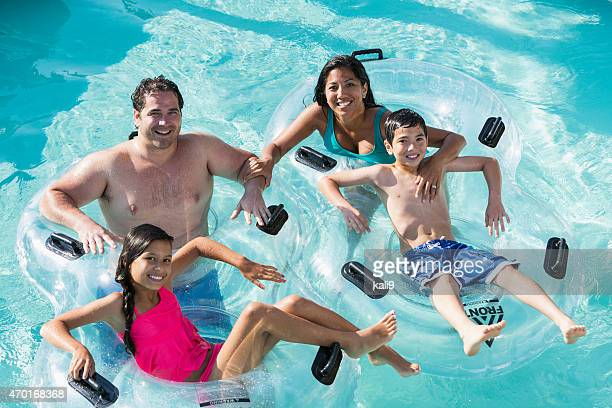 Interracial family at water park on lazy river