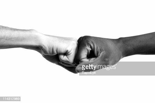 Interracial fists collide