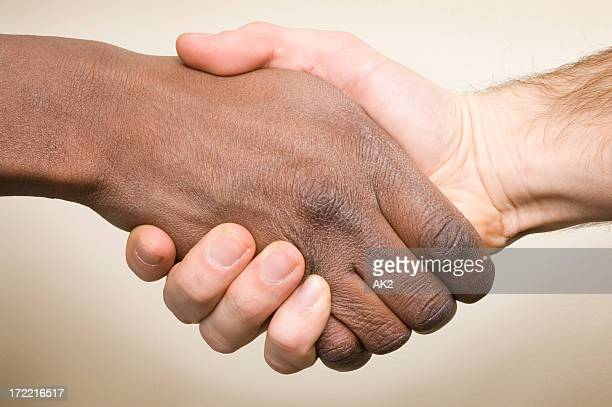 Interracial handshake