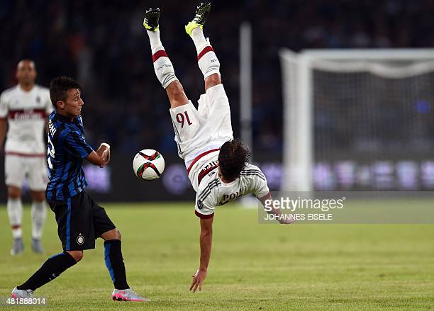 Inter's defender Enrico Baldini and AC Milan's midfielder Andrea Poli vie for the ball during the International Champions Cup football match between...