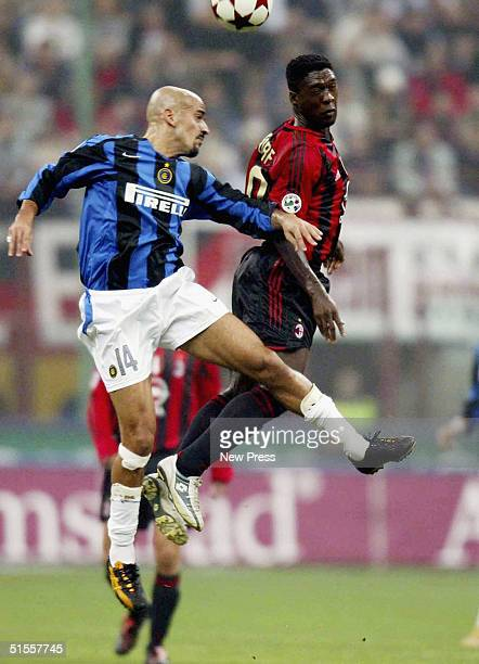 Inter's Juan Sebastian Veron goes up against by AC Milan's Clarence Seedorf during the Italian Serie A match between AC Milan and Inter Milan at the...
