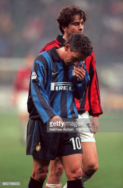 Inter's Roberto Baggio leaves the pitch depressed after his team failed to beat AC Milan