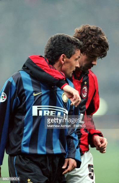 Inter's Roberto Baggio leaves the pitch depressed after his team failed to beat AC Milan with Alessandro Costacurta