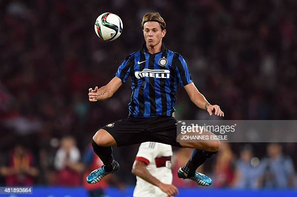 Inter's Samuele Longo vies for the ball during the International Champions Cup football match between AC Milan and Inter Milan in Shenzhen on July 25...
