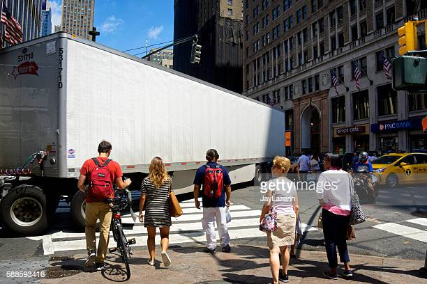 NYC Intersections, Tractor-Trailer turning while pedestrians wait, 7th Avenue, Manhattan