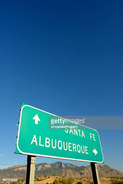 interstate road sign and desert mountain landscape