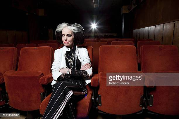 Intersting looking senior woman in movie theatre