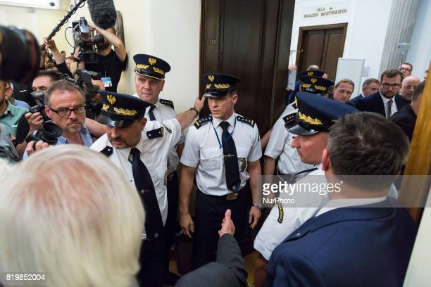 Intervention of the Marshal's Guard during a night debate on a Supreme Court bill in parliamentary commission at lower house of Polish Parliament in...