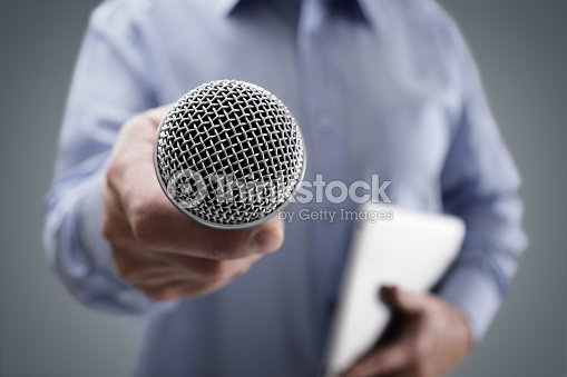Interview with microphone : Stock Photo