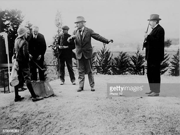 Relaxing day during which the three Presidents played a game of golf From left to right Lloyd George Ivanoe Bonomi and Aristide Briand January 9 1922...