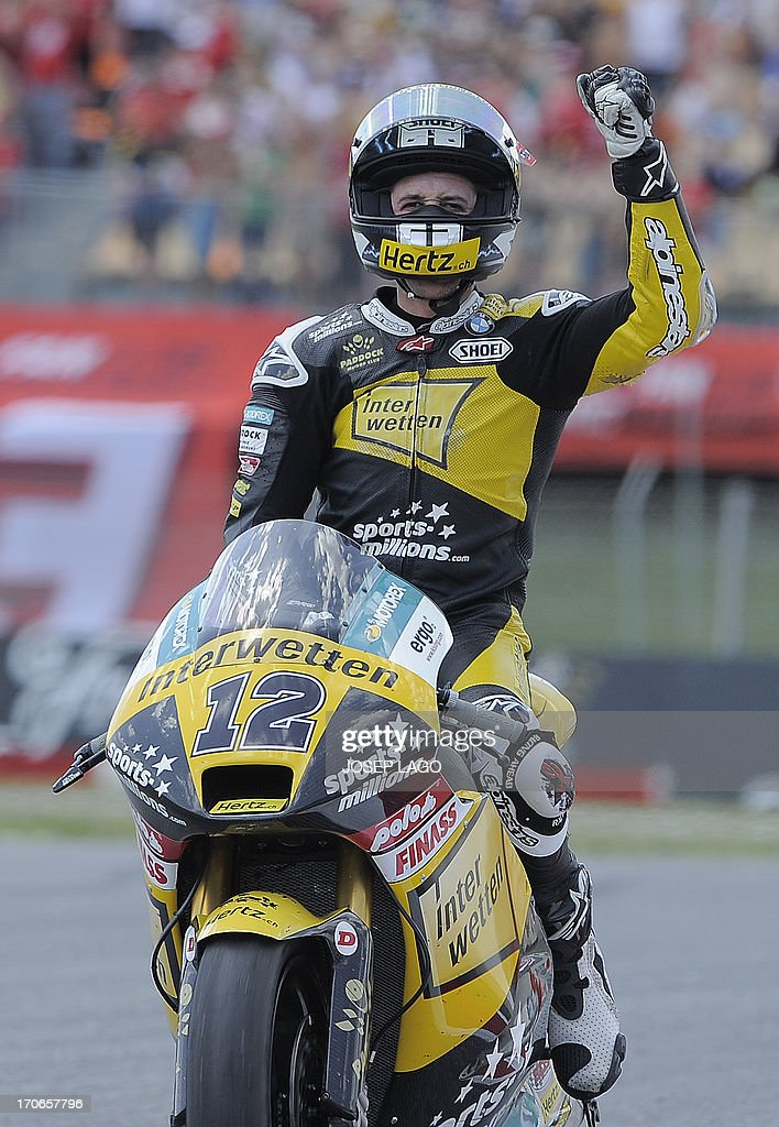 Interwetten Paddock's Racing Swiss rider Thomas Luthi celebrates his third place after the Moto2 race of the Catalunya Grand Prix at the Catalunya racetrack in Montmelo, near Barcelona, on June 16, 2013. Tuenti HP 40 Spanish Pol Espargaro won the race ahead ofTuenti HP 40 Spanish Esteve Rabat and Interwetten Paddock Racing Swiss Thomas Luthi.