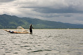 Intha fisherman on his pirogue in Inle Lake