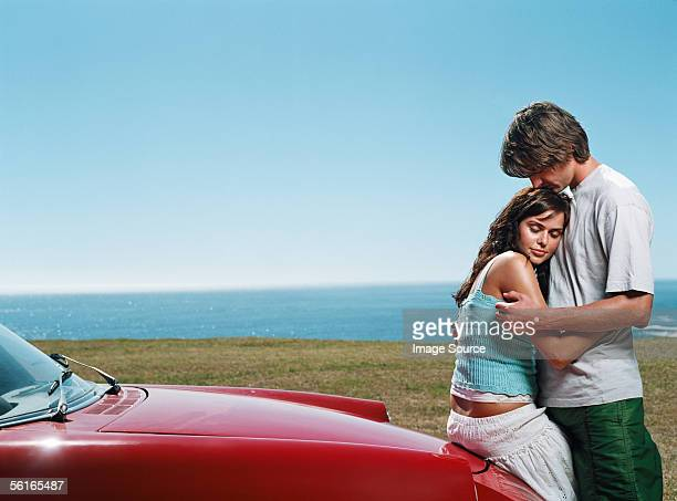 Intimate couple by vintage car