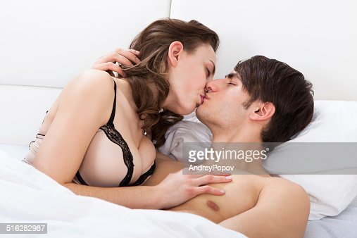Intimate Couple Kissing In Bed Stock Photo | Getty Images
