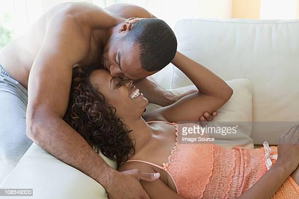 Intimate couple on sofa