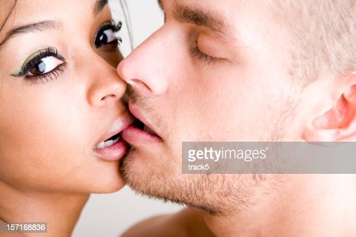 Intimate moment between a pair of kissing young lovers
