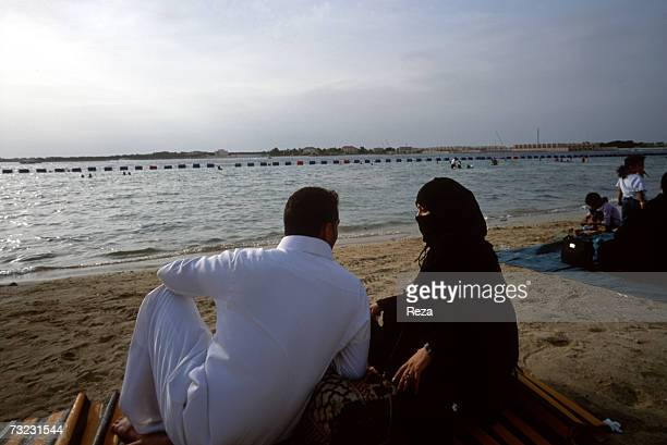 Intimate moment for a Saudi couple at a seaside resort on December 2002 in Durrat AlArus Saudi Arabia Even in warm weather all women above a certain...