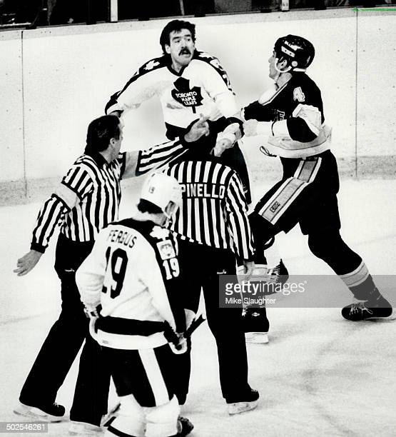 Into the fray St Louis tough guy Charlie Bourgeois wades into battle against Toronto's Brad Smith while Tom Fergus referee Bob Myers and linesman Ray...