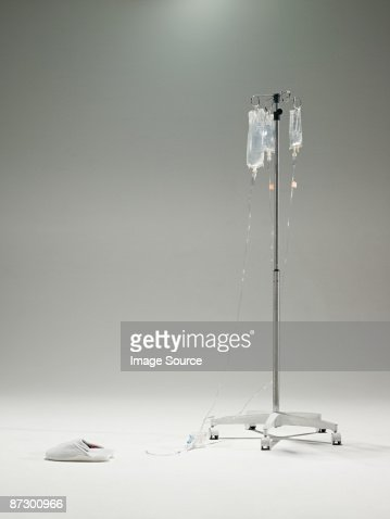 Intravenous drip and slippers : Stock Photo
