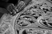 Close up of the intricate wood carving traditional to the Swahili coast of Africa, often used in door frames (in this case a door arch). Shallow depth of field.