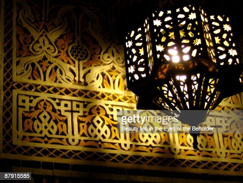 Intricate engraving and lamp : Stock Photo