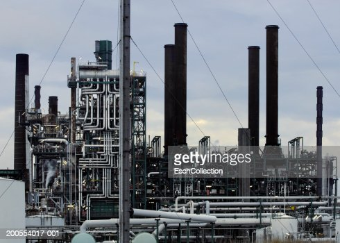 Intricate piping at oil refinery : Stock Photo