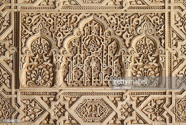 Intricate plaster work decorates a room in the Nasrid Palaces at the Alhambra on July 23 2013 in Granada Spain Southern Spain is among Europe's...