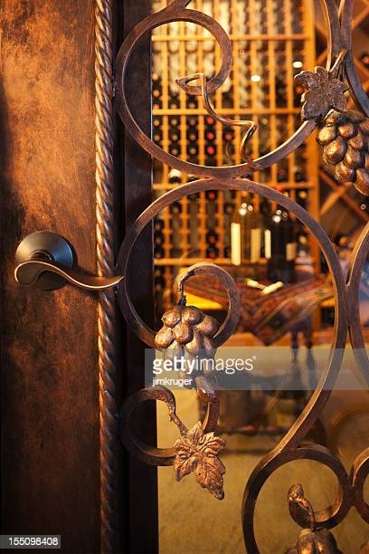 Intricate wine cellar door.