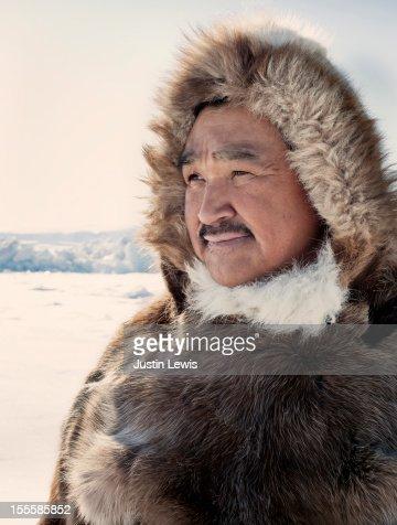 Inuit hunter in reindeer fur jacket on ice : Stock Photo