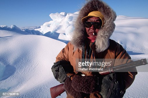 Inuit Seal Hunter Holding a Rifle