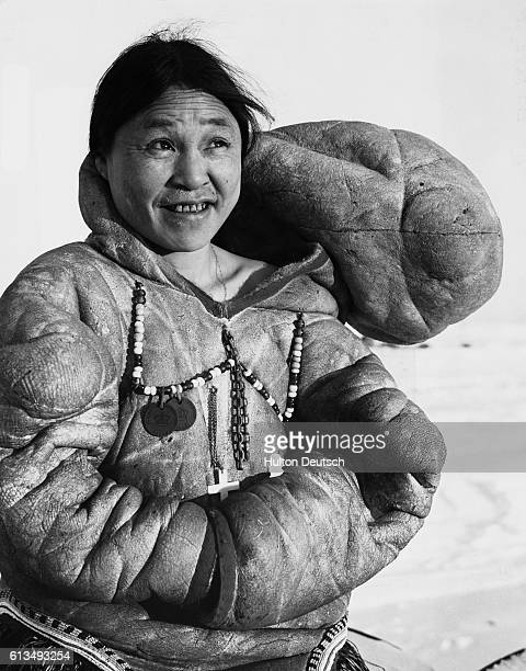 Inuit Woman Wearing Traditional Dress Eskimo woman wears the tall floppy hood of her tribe Eskimos are more properly referred to as Inuits The term...