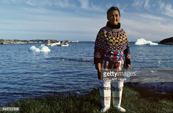 Inuit woman wears proudly her traditional costume in the village of Kagssemiut