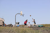 Inuit youths play basketball on the Island of Shishmaref in the Chukchi Sea Alaska The future is bleak for these Inuit children as recently their...