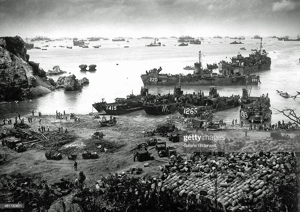 U.S. invasion forces establish a beachhead on Okinawa island, about 350 miles from the Japanese mainland. 13th April 1945. Pouring out war supplies and military equipment, the landing crafts fill the sea to the horizon, in the distance, battleships of the U.S. fleet. Japan.