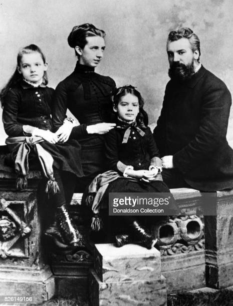 Inventor Alexander Graham Bell poses for a portrait with his wife Mabel Hubbard Gardiner Bell and his daughters Elsie Bell and Marian Bell in 1885