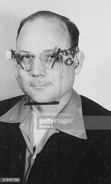 Inventor CM Copeland shows off his latest brainchild eyeglasses equipped with windshield wipers The wearer supplies power by chewing gum A horizontal...