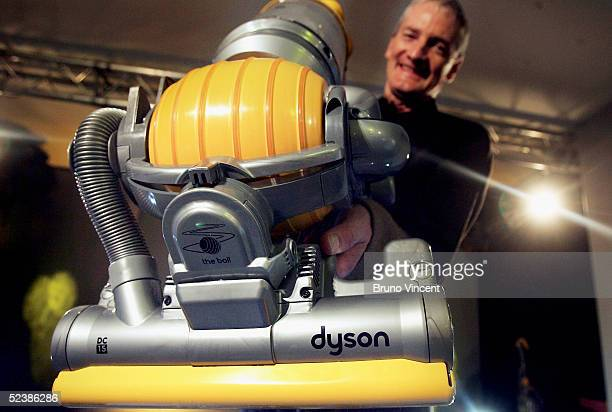 Inventor James Dyson demonstrates his latest hoovering invention on March 14 2005 in London The vaccum cleaner replaces the traditional four wheels...