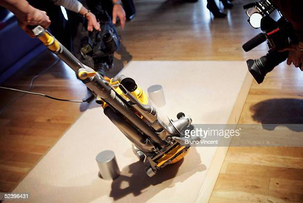 Inventor James Dyson's latest hoovering invention is demonstrated on March 14 2005 in London The vaccum cleaner replaces the traditional four wheels...
