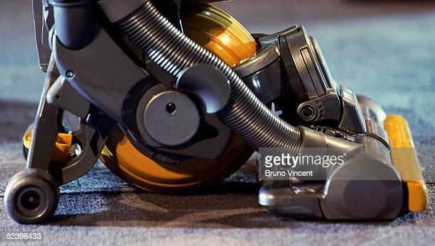 Inventor James Dyson's latest hoovering invention is seen on March 14 2005 in London The vaccum cleaner replaces the traditional four wheels with one...