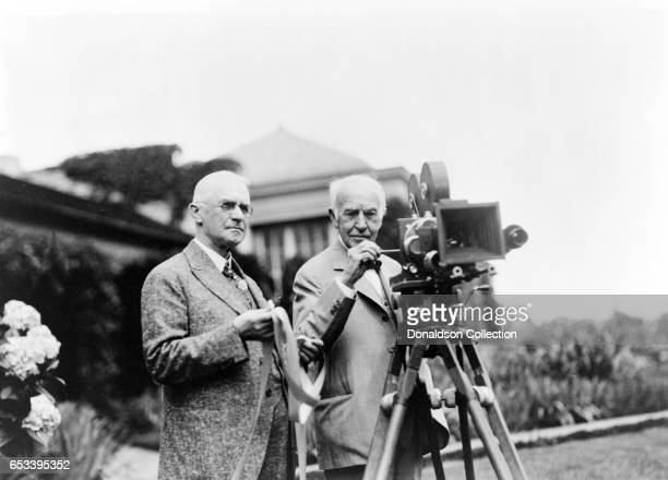 Inventor Thomas Edison and George Eastman poses for a portrait with a motion picture camera at Eastman's house in 1928 in Rochester New York