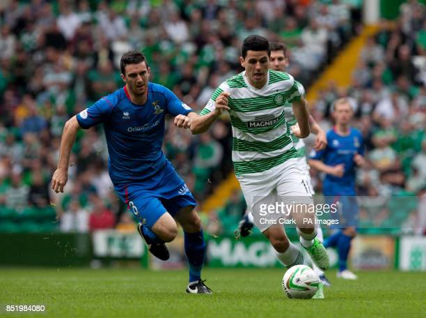 Inverness's Graeme Shinnie vies for the ball with Celtic's Tomas Rogic during the Scottish Premiership match at Celtic Park Glasgow