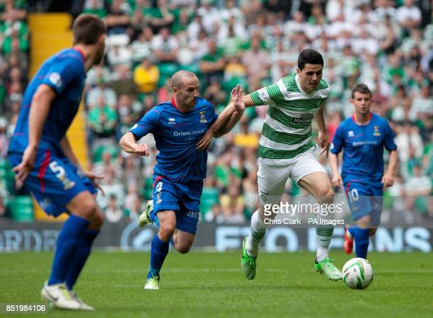 Inverness's James Vincent vies for the ball with Celtic's Tomas Rogic during the Scottish Premiership match at Celtic Park Glasgow