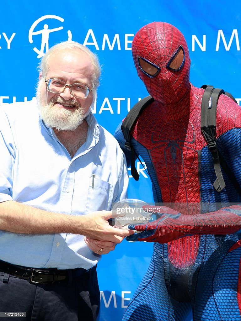 Invertebrate Zoology curator Norman Platnick and Spider-Man display a Chilean Rose Tarantula at the American Museum of Natural History on June 27, 2012 in New York City.
