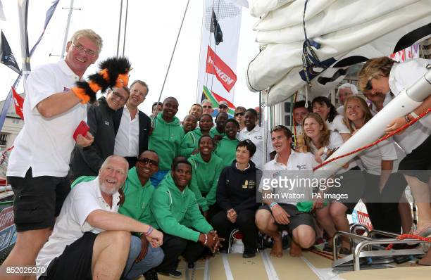 Invest in Africa crew members with Dame Ellen MacArthur during the start of the Clipper Round the World Race at St Katharine Docks London